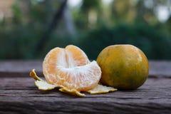 The orange on wooden background Royalty Free Stock Image