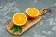Orange on a wooden background. Top view. Free space for text. Stock Image