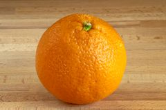 orange on a wooden board stock photo