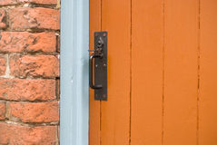 Orange wooden door. Victorian house. Suffolk, UK Stock Image