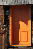 Orange wooden door Stock Photography
