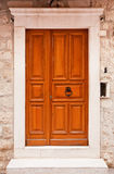 Orange wooden doors in Dubrovnik, Croatia Stock Images