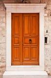 Orange wooden doors in Dubrovnik, Croatia stock images