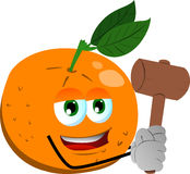 Orange with a wooden hammer Stock Images