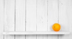 Orange on a wooden shelf. Stock Photos