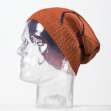 Orange woolen handmade cap basketball ball alike Royalty Free Stock Photo