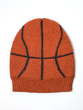 Orange woolen handmade cap basketball ball alike Stock Images