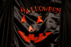Orange word spelling Halloween on black cloth Stock Photography