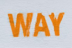 Orange word way written on white wall. Way as sign, background or wallpaper. Calligraphy, text sign stock images