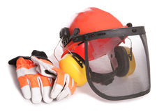 Orange workers helmet gloves and ear protectors Royalty Free Stock Photos
