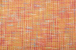 Orange woven with threads plaid fabric. Stock Photos