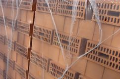 Orange wrap packed bricks ready for construction site Royalty Free Stock Photography