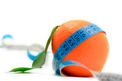 Orange wrapped around a tape stock photos