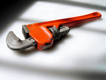 Orange Wrench. A weathered orange wrench. The perfect handyman's tool or metaphor Royalty Free Stock Image