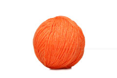 Orange yarn ball over white Stock Photography