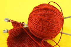 Orange yarn and knitting needles Stock Photography