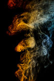 Orange - yellow - blue abstract smoke on white background. Royalty Free Stock Images