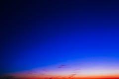 Orange, Yellow Blue Sunrise Sky With Sunlight Royalty Free Stock Photo