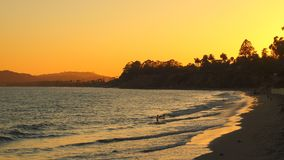 Summer sunset on the horizon across California beach. Orange yellow colors of summertime vacationland sunset in California Royalty Free Stock Image