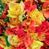 Orange and yellow fake roses Stock Photo