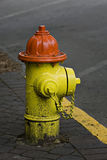 Orange and yellow fire hydrant Royalty Free Stock Photos