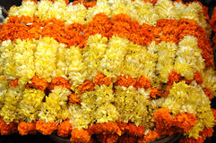 Orange and yellow flower garlands, goa, india. Orange and yellow flower garlands, used in hindi religion in india. goa flower market Royalty Free Stock Images