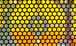 Orange and yellow geometric background. Made by a metallic net Royalty Free Stock Photography