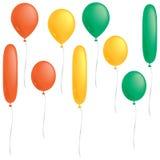 Orange, yellow and green balloons. A selection of orange, yellow and green balloons isolated on white Royalty Free Stock Photos