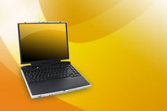 Orange Yellow Laptop. A black laptop with a yellow screen is against a pattern background. Use this area for your text Royalty Free Stock Photo