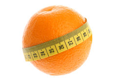 Orange with yellow measuring tape as losing weight Royalty Free Stock Photography