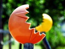 Orange and yellow plastic exercise equipment in playground Stock Photography