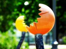 Orange and yellow plastic exercise equipment in playground Stock Image