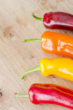orange, yellow and red bell pepper. stock image