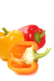 Orange, yellow and red bell peppers Stock Photos
