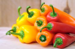 Orange, yellow and red bell peppers Stock Photography