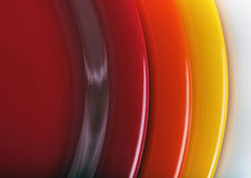 Orange, yellow and red colored  plates stacked upon each other Royalty Free Stock Photos
