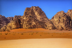 Orange Yellow Sand Rock Formation Valley of Moon Wadi Rum Jordan. Orange Yellow Sand Rock Formation Wadi Rum Valley of the Moon Jordan.  Inhabited by humans Royalty Free Stock Photography