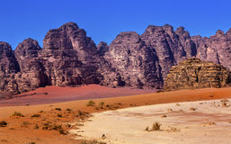 Orange Yellow Sand Rock Formation Valley of Moon Wadi Rum Jordan. Orange Yellow Sand Rock Formation Wadi Rum Valley of the Moon Jordan.  Inhabited by humans Royalty Free Stock Photos