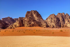 Orange Yellow Sand Rock Formation Valley of Moon Wadi Rum Jordan. Orange Yellow Sand Rock Formation Wadi Rum Valley of the Moon Jordan.  Inhabited by humans Stock Photography