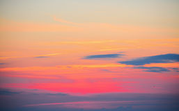 Orange and yellow sky with clouds. At sunset Royalty Free Stock Photo