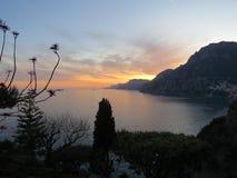 Sunset on the gulf of Naples. Amalfi Coast. Italy. Orange and yellow sunset on the gulf of Naples. Amalfi Coast. Italy Royalty Free Stock Photo