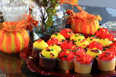 Orange and Yellow Thanksgiving cupcakes Royalty Free Stock Images