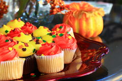Orange and Yellow Thanksgiving cupcakes Stock Photo