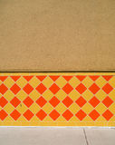 Orange & Yellow tiled wall Royalty Free Stock Images