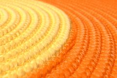Orange and yellow wicker mat texture as background. Closeup stock photography