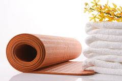 Orange yoga mat Stock Images