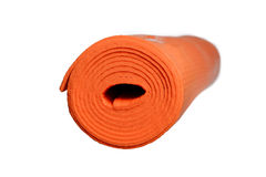 Orange yoga mat on a white background Royalty Free Stock Photo
