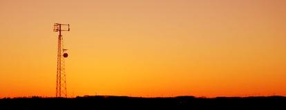 Orange Zellen-Kontrollturm-Schattenbild Stockfotos
