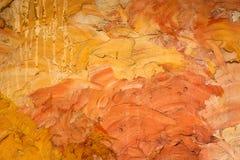 Orange Zementwandhintergrund und gemasert Stockbilder