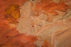 Orange Zementwandhintergrund und gemasert Lizenzfreie Stockbilder